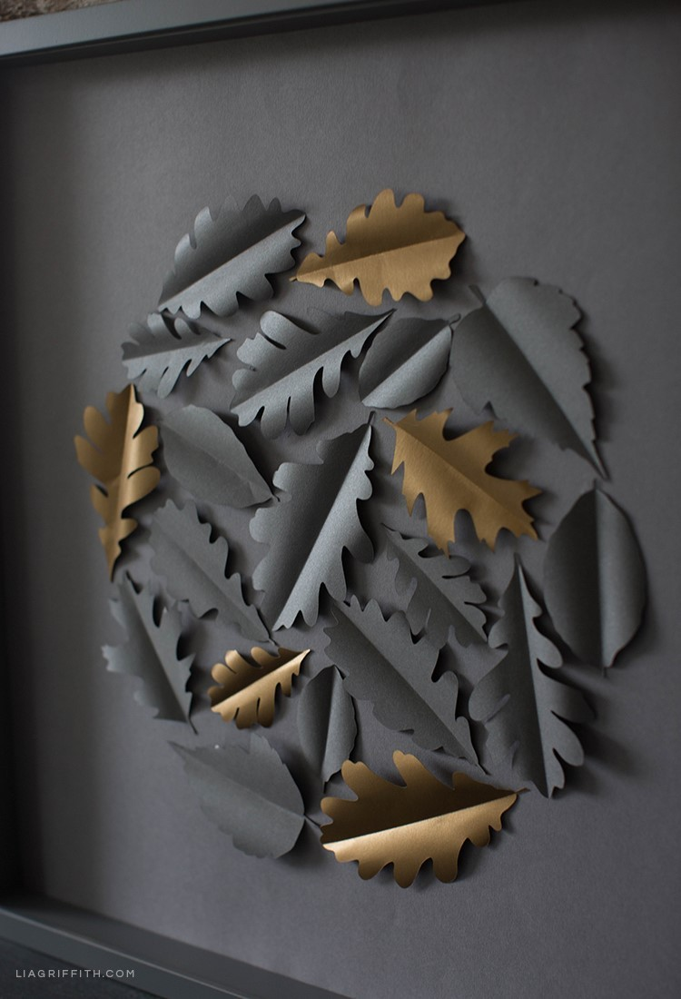 Grey and gold papercut leaves on framed art