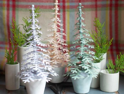 paper holiday trees in pots on mantel