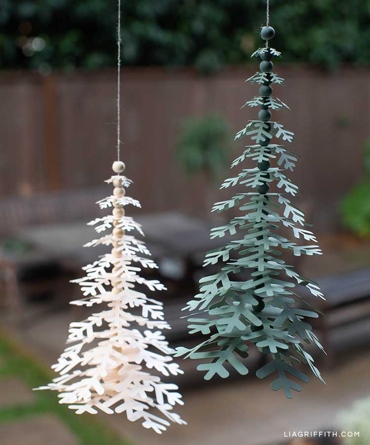 paper holiday trees hanging from window