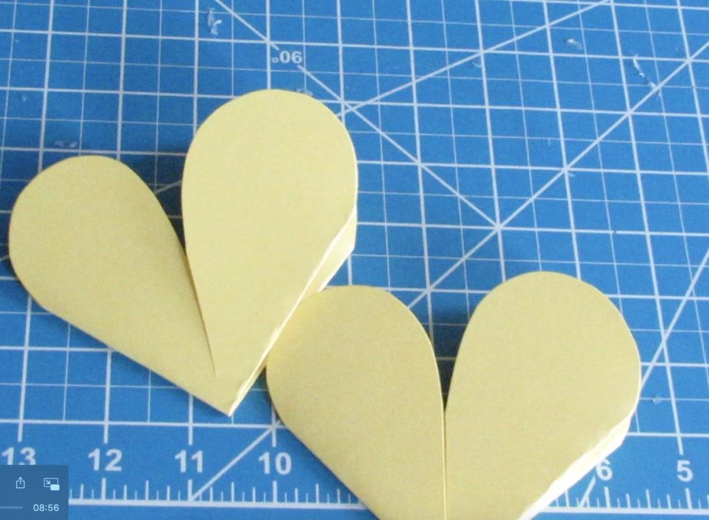 Cut each side, half hearts